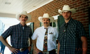 Luke Mobley, Kevin Thompson, and Kerry Collins at a Gelbvieh Sale in NC.
